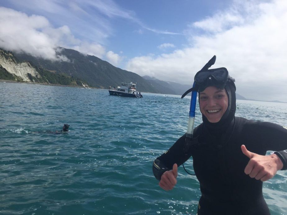 Me in snorkel gear with Kaikoura in the background after swimming with dolphins