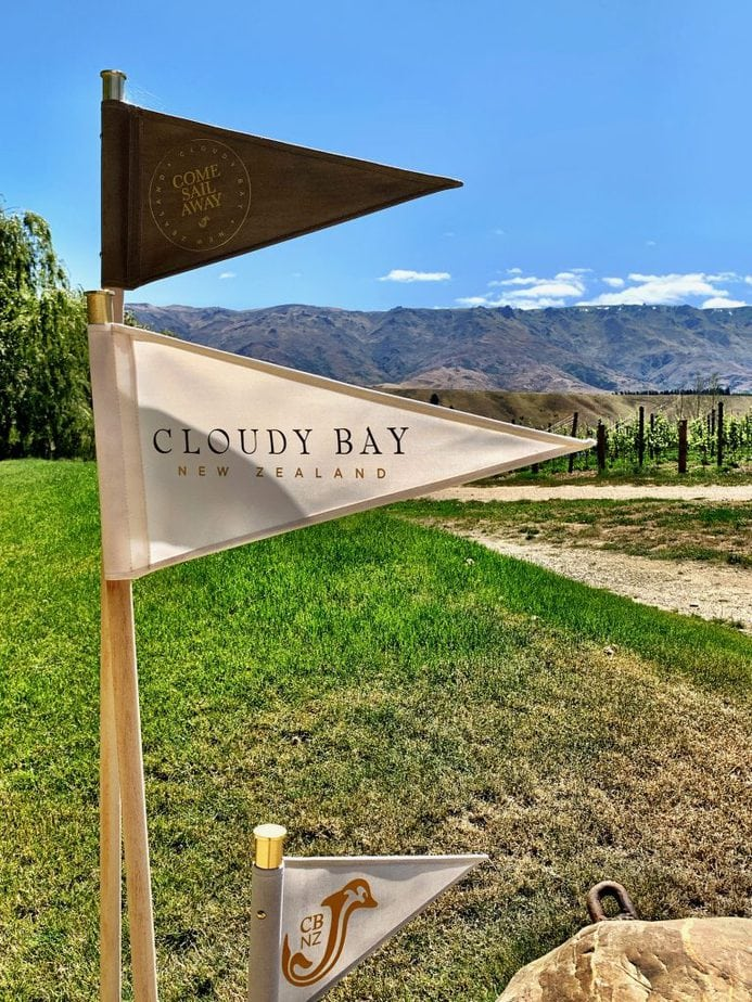Mini Pennant Flags on a pole at the entrance to the Cloudy Bay Vineyard in Central Otago, NZ