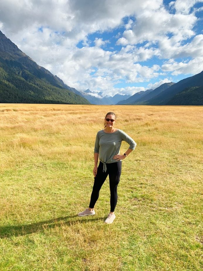 Me standing in a field in Fiordland National Park