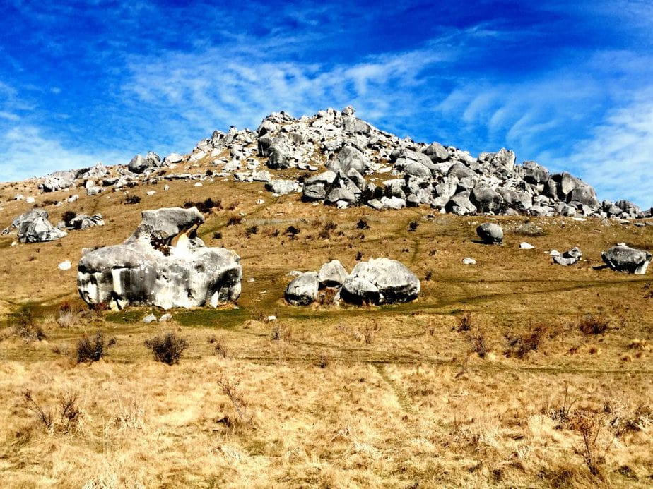 Boulders scattered on a blue sky day near Arthurs Pass, New Zealand