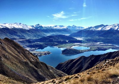 View of Lake Wanaka and the snow covered mountain range from the top of Roy's Peak