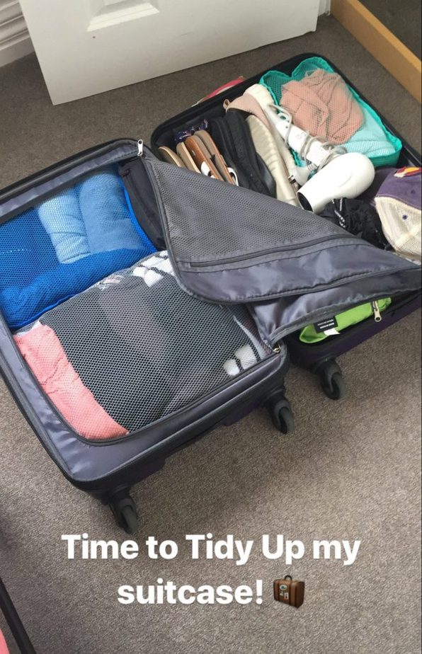 Picture of a digital nomad suitcase that is ready to go through the KonMari method of tidying up