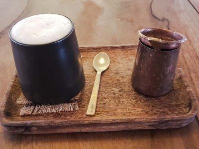 Kar.ma Coffee served on a wooden tray in Nepal, Kathmandu