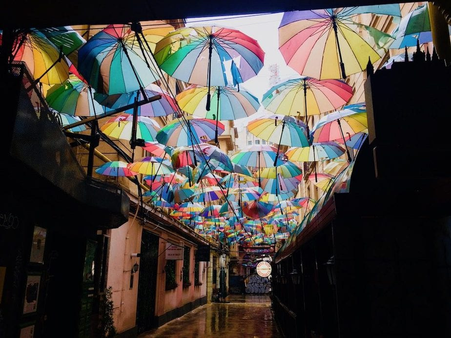 A pretty little passageway covered with loads of colorful umbrellas at Pasajul Victoria