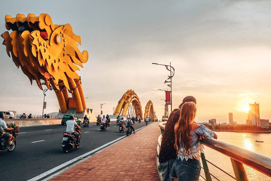 Bay area with huge dragon steel structure on the bridge and people watching sunset in Da Nang, Vietnam for the ultimate freedom location lifestyle