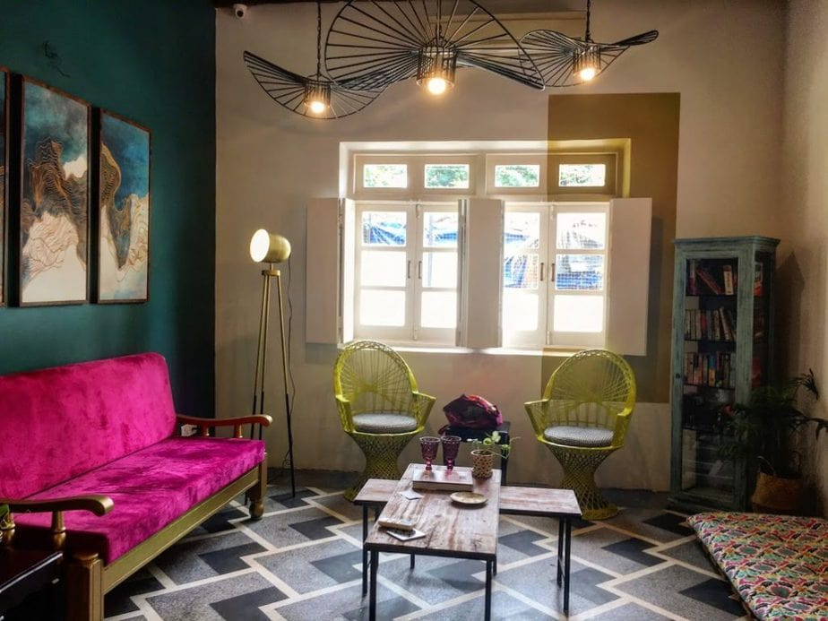 A co-working space with lights and fuchsia couch in Barabor: A co-working space in Betim, Goa