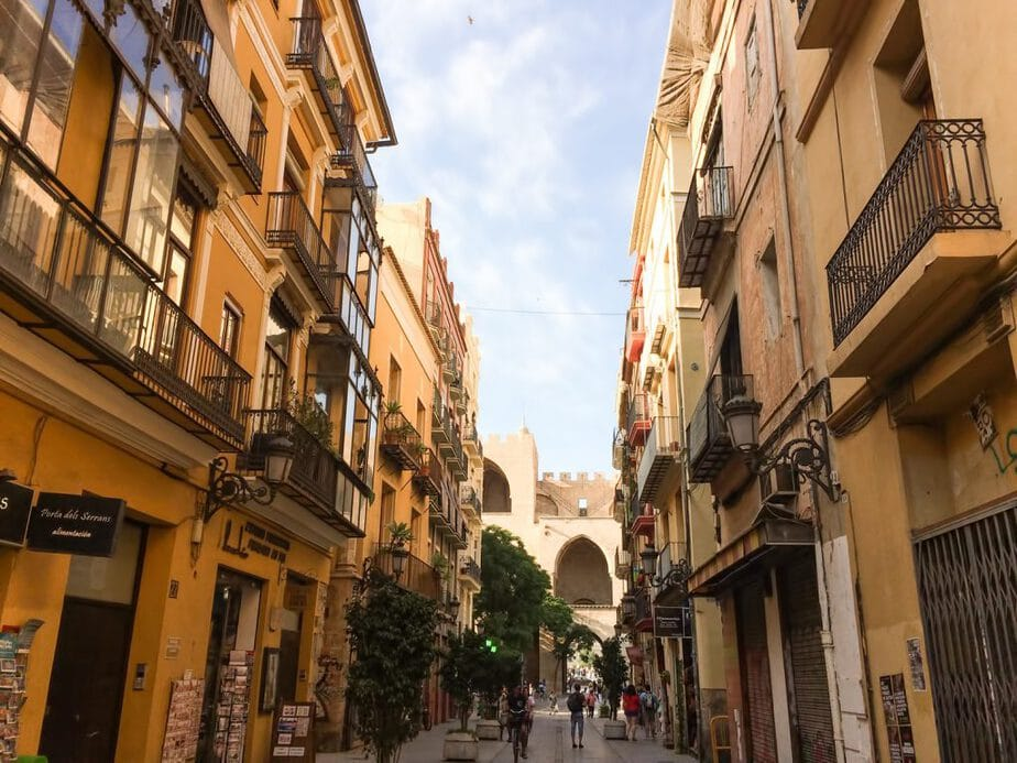 An alley with buildings and cafes in Valencia, Spain