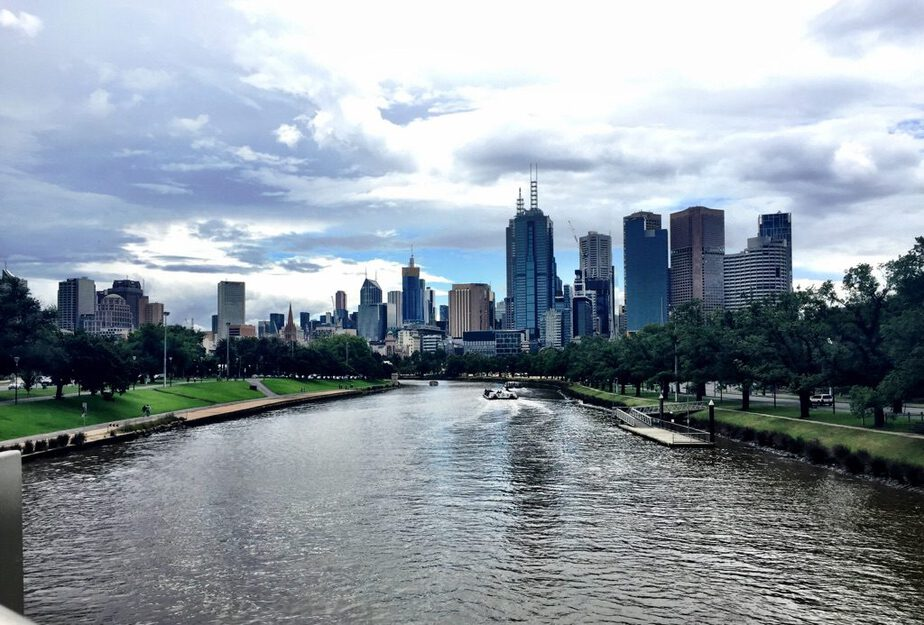 Standing on a bridge overlooking the Yarra River and the skyrises of Melbourne on a nice but cloudy day is one of the best cities for digital nomads
