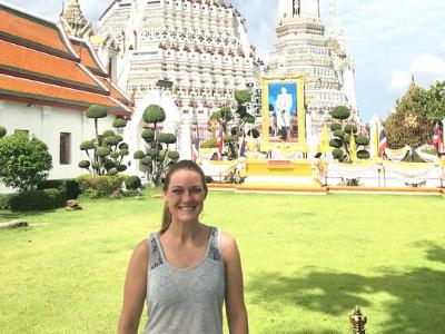 Girl posing in front of traditional worship buildings in Bangkok